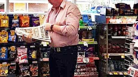 Barnaby Joyce reads the Daily Telegraph in a service station this morning. Picture: Supplied