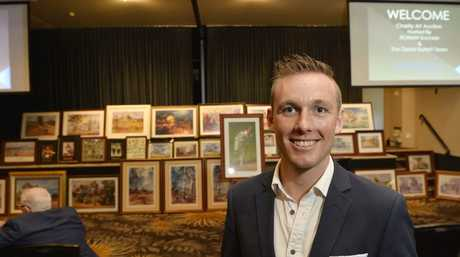 Remax sales agent James O'Donohue gets ready for a Make-A-Wish charity auction of private collection of work by the late artist d'Arcy Doyle at City Golf Club, Sunday, February 18, 2018.