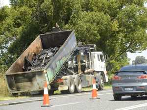 Rubbish truck's load catches alight
