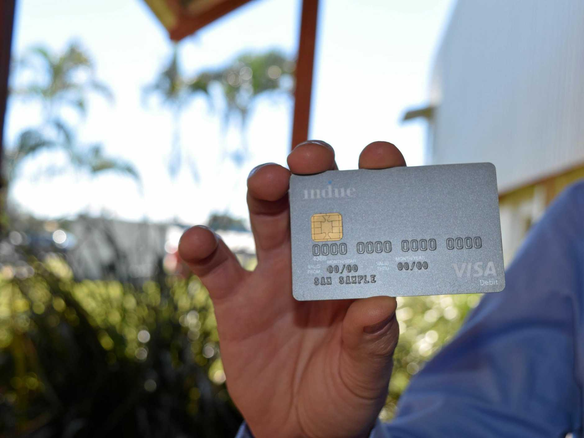 Human Services Minister Alan Tudge shows what the cashless welfare card will look like.