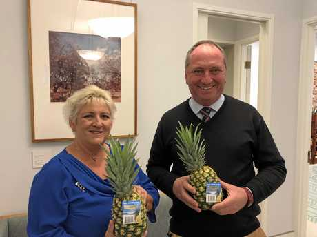 ROUGH SITUATION: Federal member for Capricornia Michelle Landry delivering a pineapple to Deputy Prime Minister, Barnaby Joyce MP
