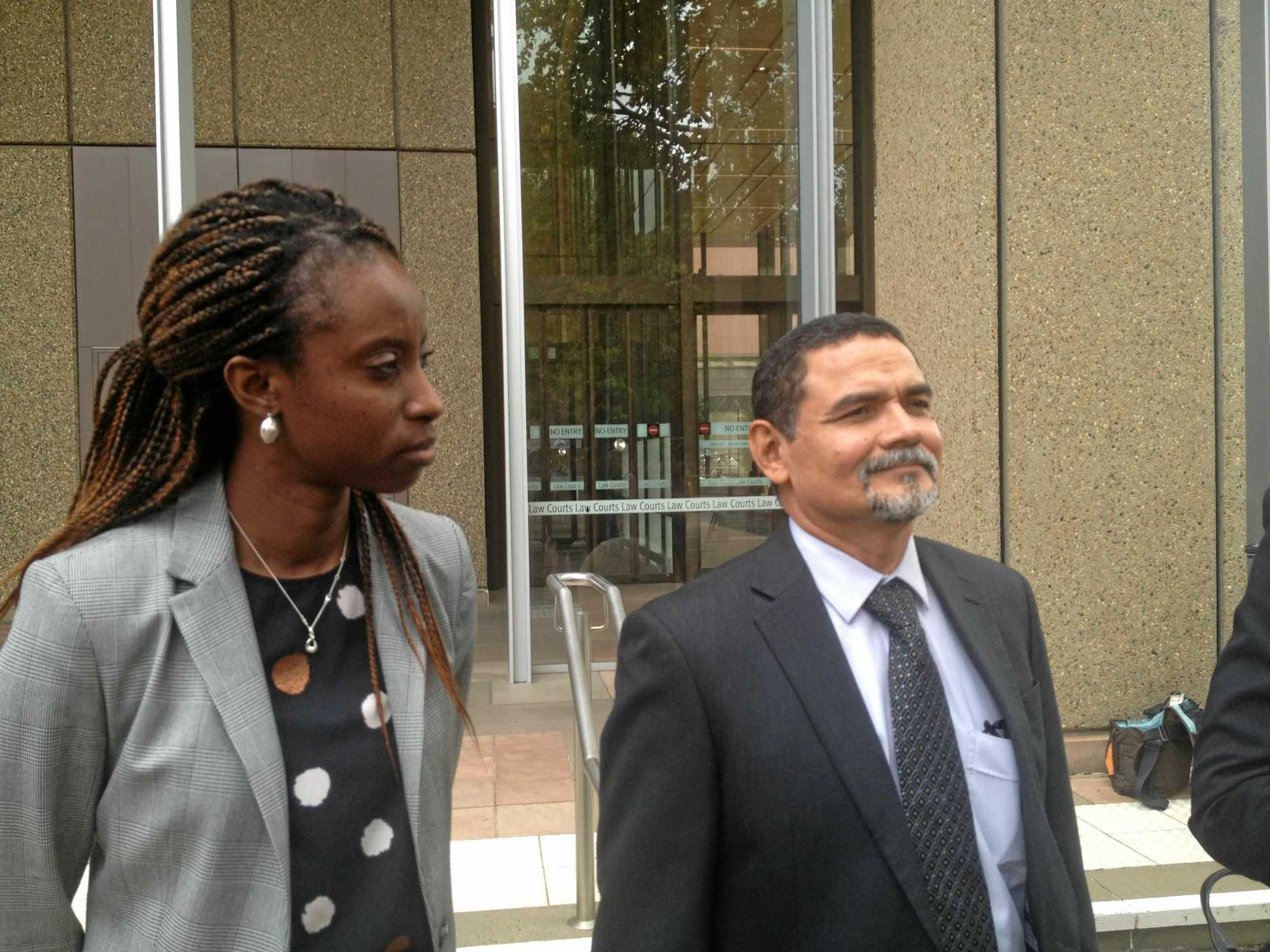 Maurice Blackburn principal Vavaa Mawuli and lead claimant, Fairfield Garden's sports shop owner Vince Rodriguez, outside NSW Supreme Court. They are involved in the class action related to the 2011 floods in south-east Queensland.
