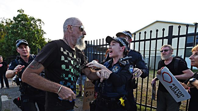 A Townsville man clashes with anti-Adani protesters. Picture: Zak Simmonds