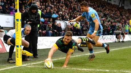 Rob Horne scores Northampton's second try against London Irish at Franklin's Gardens.