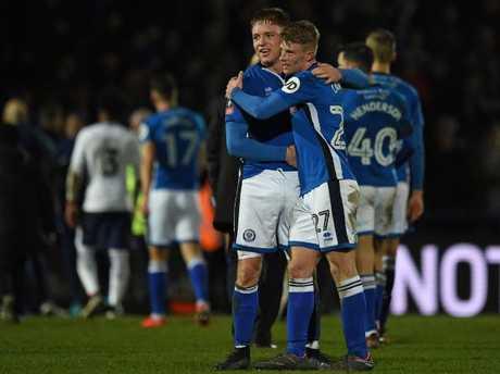 Rochdale's English midfielder Oliver Rathbone (centre left) and Rochdale's English midfielder Andy Cannon celebrate.