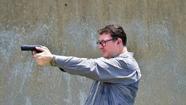 Photo from George Christensen MP's Facebook page of him shooting a handgun.