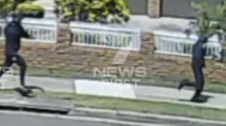 The two gunman fleeing the scene of the shooting in Rockdale. Picture: 7 News