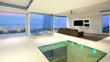 The home has a glass floor between the living space upstairs and the chill-out space below.