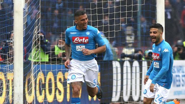 Napoli's Allan, left, celebrates.