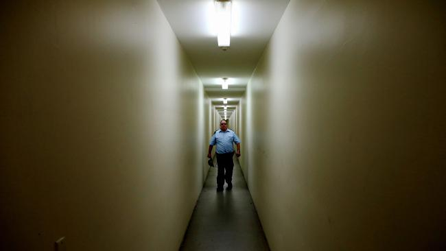 A prison guard walks the corridors of Silverwater Correctional Facility in western Sydney. Picture: Adam Taylor
