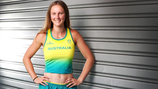 Riley Day tries on her uniform after sealing her place in Australia's team for the Commonwealth Games. Picture: NIGEL HALLETT