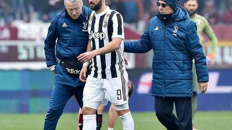 Juventus's Gonzalo Higuain, centre, leaves the pitch.