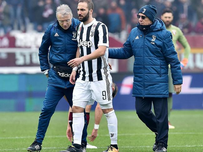 Juventus's Gonzalo Higuain, centre, leaves the pitch.