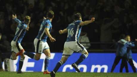 Rochdale players celebrate.