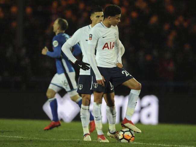 Tottenham's Dele Alli reacts after Rochdale scored to make it 2-2.
