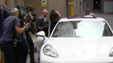 Salim Mehajer appeared to slam the door shut on Laura Banks before the Porsche quickly left. Picture: Channel 7