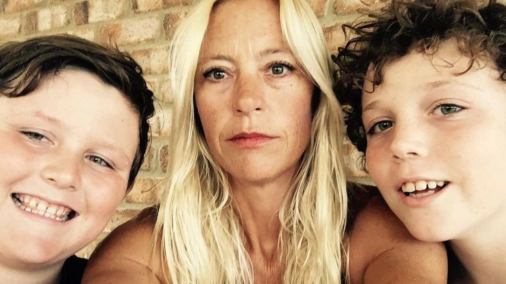CLOSE CALL: Woolgoolga local Kathy Haines (centre) and her two sons Nickolas and Jamie were rescued from a rip at Woolgoolga's Main Beach at the weekend.