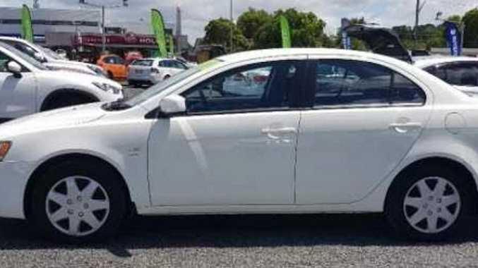 The white 2011 Mitsubishi Lancer.