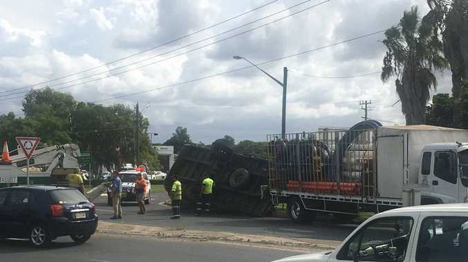 Chaotic scenes at a busy South Grafton intersection as afternoon traffic negotiates an overturned truck.