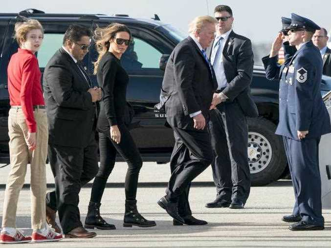 President Donald Trump accompanied by first lady Melania Trump and their son Barron Trump board Air Force One at Palm Beach International Airport in West Palm Beach Fla. Monday Feb. 19 2018 to travel to Andrews Air Force Base Md