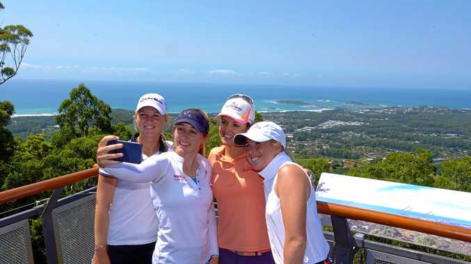 SELFIE TIME: Camille Chevalier, Chloe Leurquin, Christine Wolf and Casey Danielson grab a pic while checking out the Coffs Coast from the Sealy Lookout vantage point.