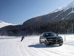 Snowboarder Jamie Barrow breaks Guinness World Record for fastest speed on a snowboard towed by a vehicle behind a Maserati Levante S.