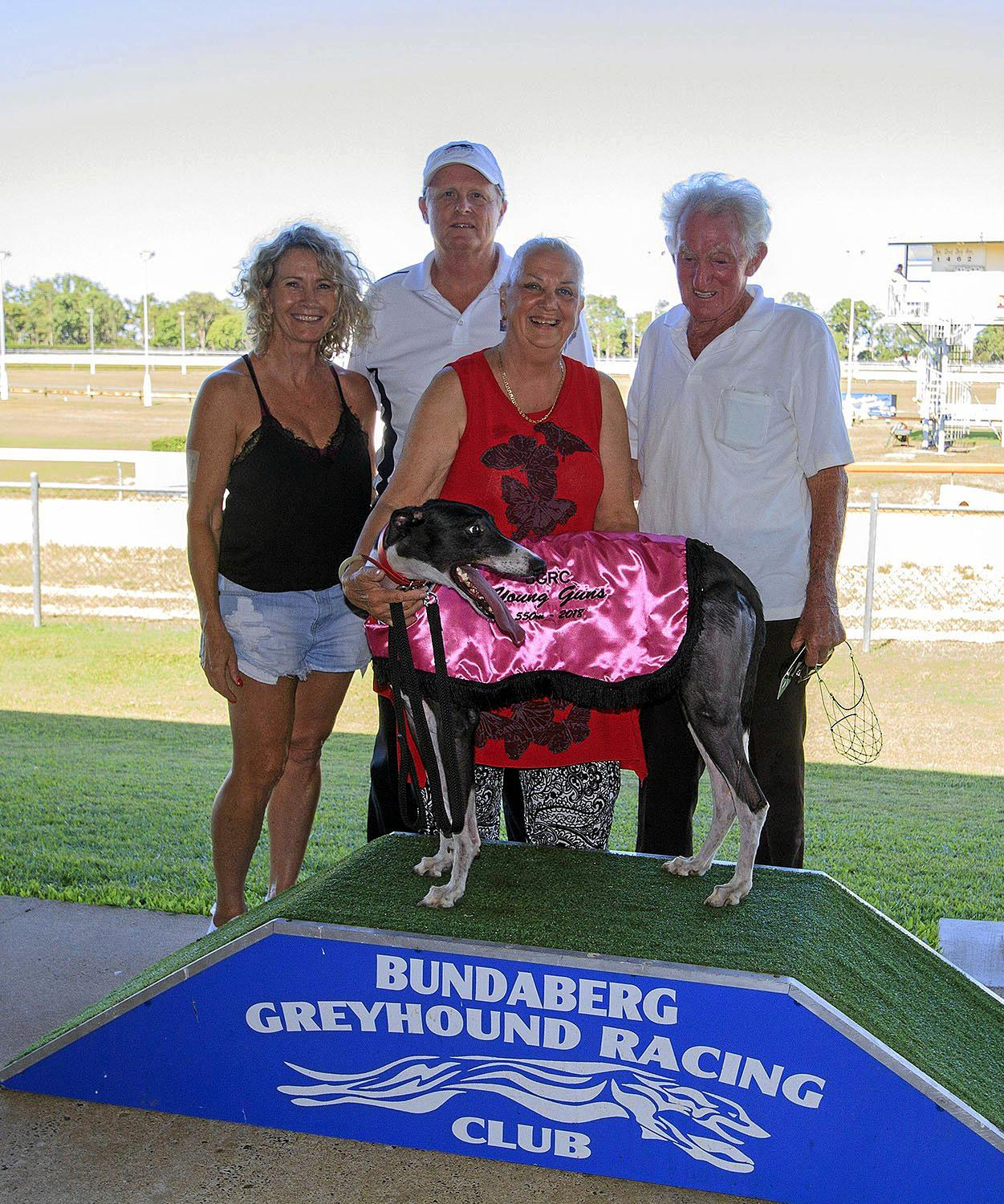 ALL SMILES: Foxy Fireball with owners Nancy and David Plummer and her trainers Graeme and Marie Richards