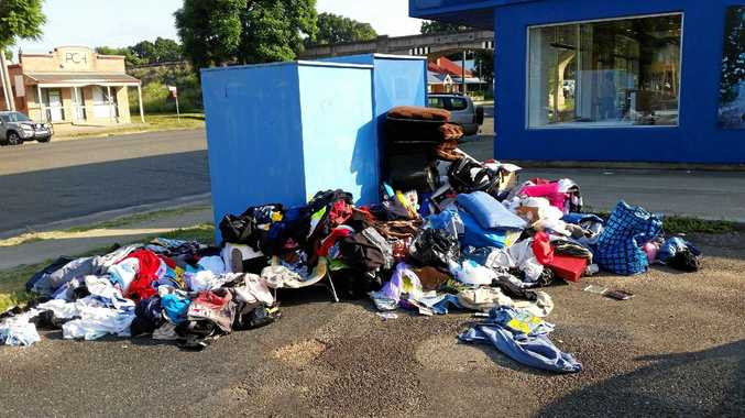 EYESORE: Rubbish and items scattered around the Lifeline clothing bins in Grafton. The clean up is costing the charity thousands of dollars a year.