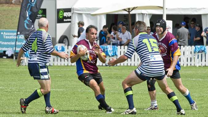 Tane Davis of Rum Pigs looks to break the defence of Grain Train during last Saturday's Aubigny Tens Division Two match at Gold Park.