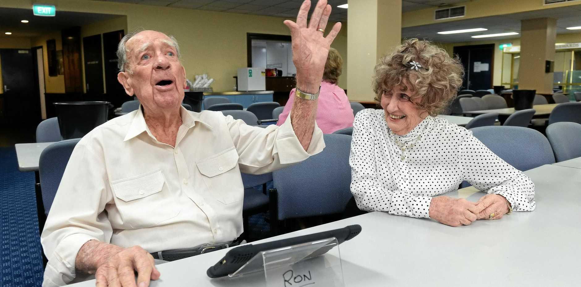 LOVING LIFE: Ron Bateman turns 100. He loves playing bingo at CSI. Here he is calling bingo next to his wife, Fay. His secret? Good food.