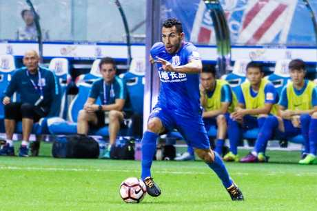 Carlos Tevez in action for Shanghai Shenhua.