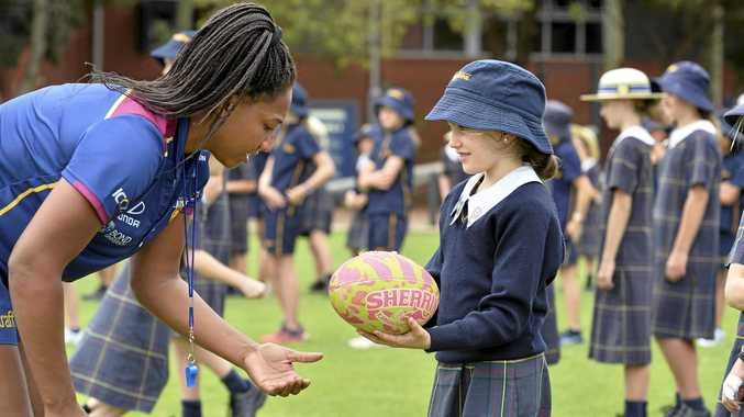 LIONS VISIT: Women's player Sabrina Frederick-Traub gives tips to Jorja Kennedy during the Brisbane Lions visit to Fairholme College.