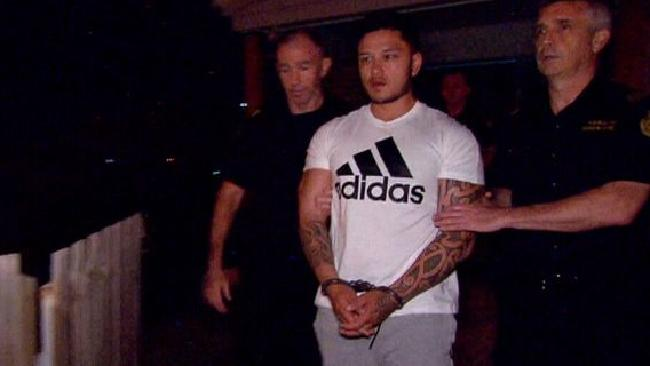Caleb Maraku escorted out by Border Force officers.