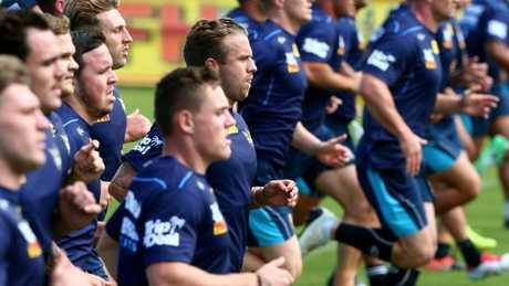 Gold Coast half Kane Elgey is seen during training.