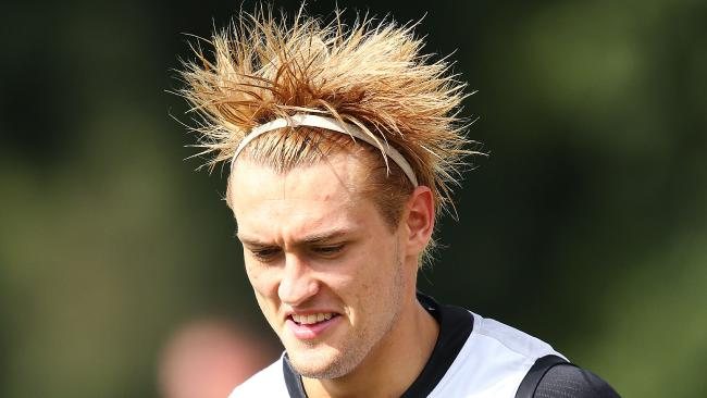 Darcy Moore of the Magpies sports a new hair style during a Collingwood Magpies AFL training session.