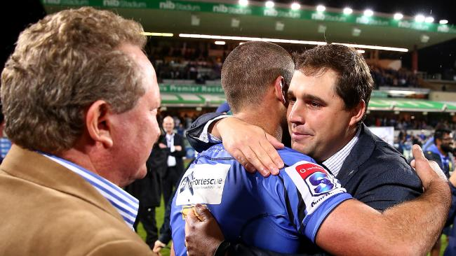Dave Wessels, then the Force coach, embraces Matt Hodgson after winning the round 17 Super Rugby match against NSW at nib Stadium.