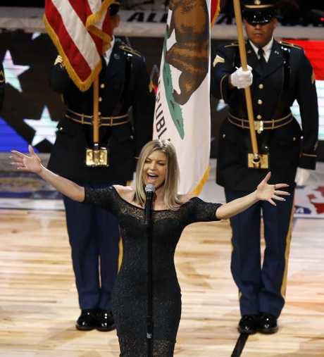 Singer Fergie sings the national anthem before an NBA All-Star basketball game, Sunday, Feb. 18, 2018, in Los Angeles.