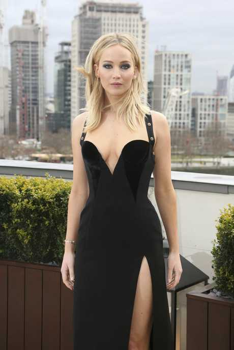 Actress Jennifer Lawrence poses for photographers at the photo call for the film 'Red Sparrow' in London, Tuesday, Feb. 20, 2018.