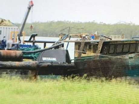TOUGH TASK: Police have cordoned off an area at the Port of Bundaberg as crew work to raise MV Dianne to the surface.