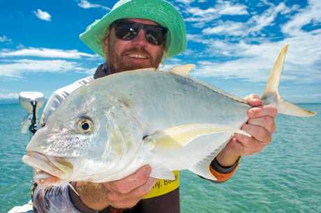Daniel (Halpo) Halpin with a nice golden trevally caught sight casting with a fly rod on a local flat with Reel Addiction Sport Fishing.