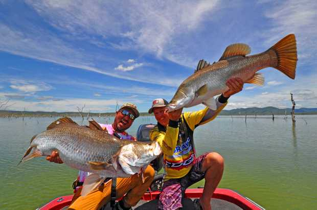 DOUBLE HOOK-UP: Japanese fishing guru Takuma Hata reels in the big barra at Lake Proserpine at the weekend with ABT champion angler Craig Griffiths.