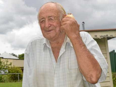 78-year-old Halwyn Herrmann of Lowood predicts rainfall using onions.