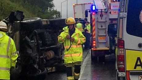 UPDATE:  Paramedics are assessing one adult and two young children at the scene of a car roll-over on the Bruce Highway.