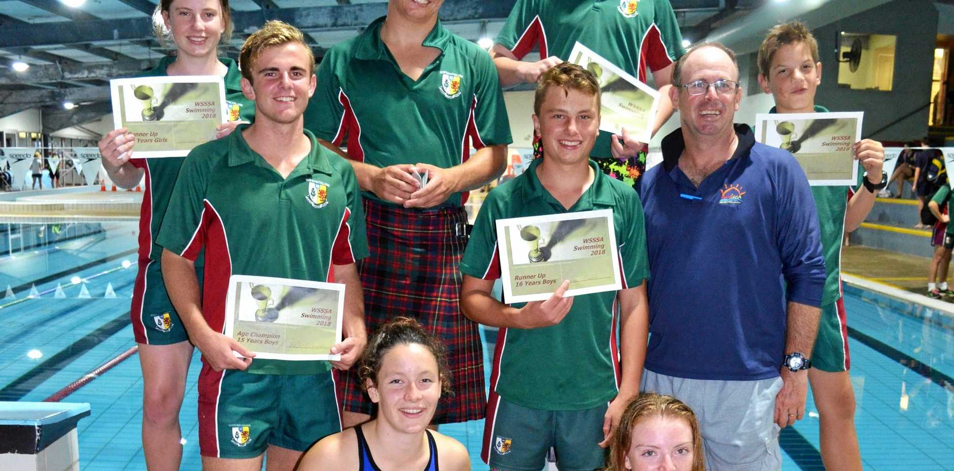 SCOTS PGC COLLEGE WINNERS: (Back, from left) Rosemary McDonald, Thomas Winter, Max Keable, Lachlan Woods, (middle) William Gilmore, Thomas Keable, staff member Tom Bradbury, (front) Shona McFarland and Emily Rhodes after the Warwick All Schools Swimming.