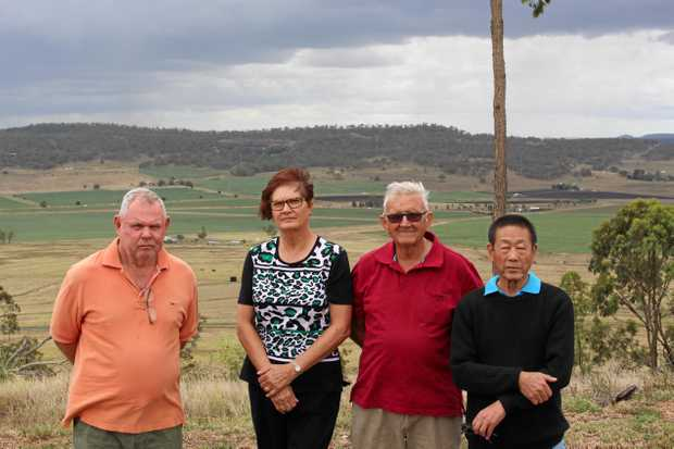FLARING UP: Mt Tabor residents Bob Platt, Meryl Strand, Brian Moore and Thomas Shew said they were supportive of renewable energy, but the proposed location for the 154-hectare solar farm would be a 'tragedy' for the Southern Downs region