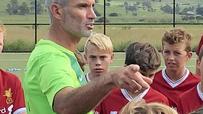 TALKING SHOP: Craig Foster speaking with young soccer players at Southern Cross University Football Centre.