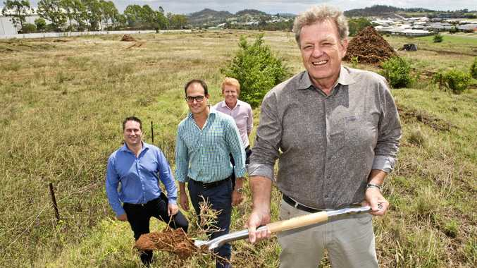 SOD TURNS: Richard Mason from SMEC, Matthew Dawson from Hutchinson Builders, Matt Nielson, Nielson Project Management and Phil Goodman, CEO Pradella Property Ventures turn the soil at the site of a new $71m resort.