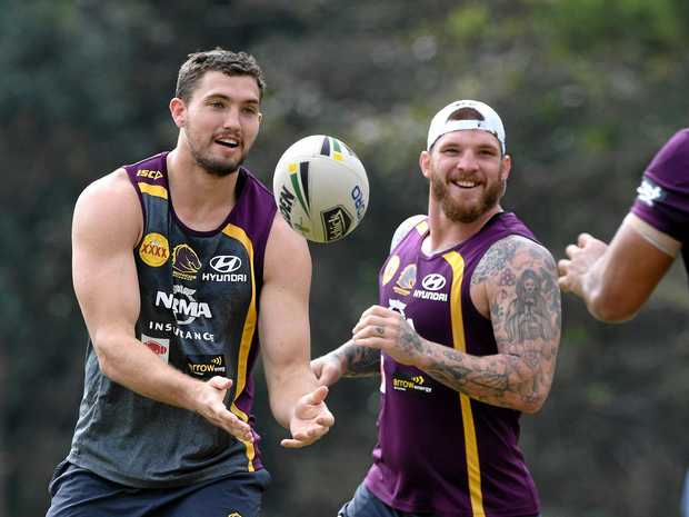 Corey Oates (left) and Josh McGuire share a joke at training.