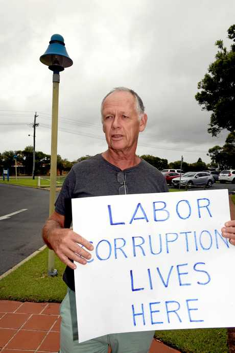 State Minister for Local Government, Stirling Hinchliff, visited the Hervey Bay Chambers of the Fraser Coast Regional Council.  Therese and Karl Adolfsen were two of three protestors waiting to voice their frustration to the minister.