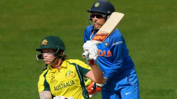 India wicketkeeper Sushma Verma looks on as Meg Lanning hits out during last year's ICC Women's World Cup.